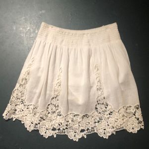 White designed skirt from the store Garage